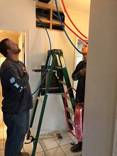 plumbers repiping a home