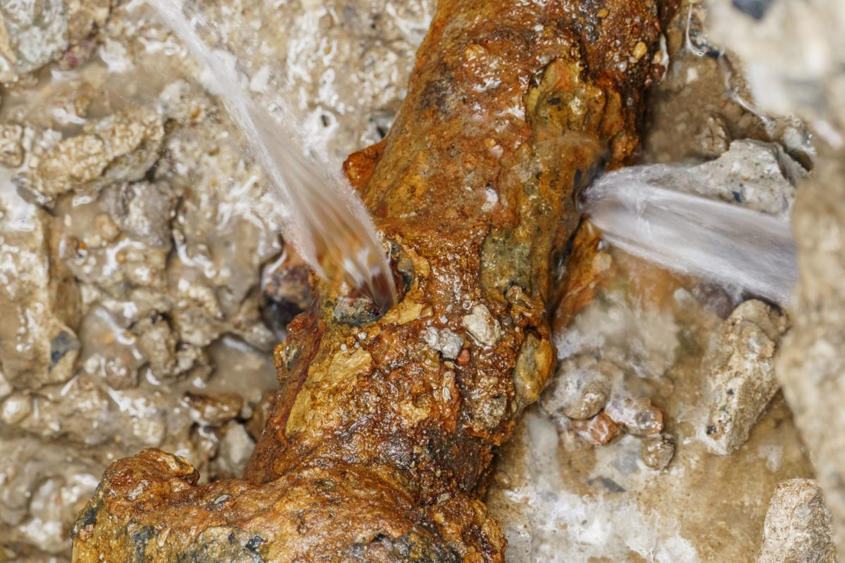 a rusted, corroded galvanized plumbing pipe