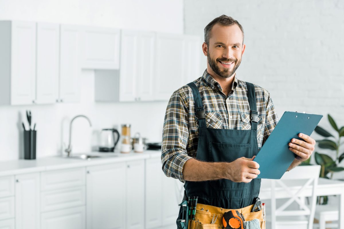 plumber reading off services from clipboard